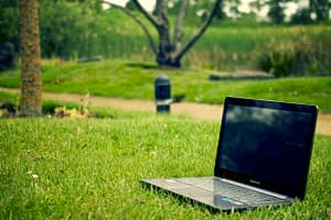 a laptop on the grass