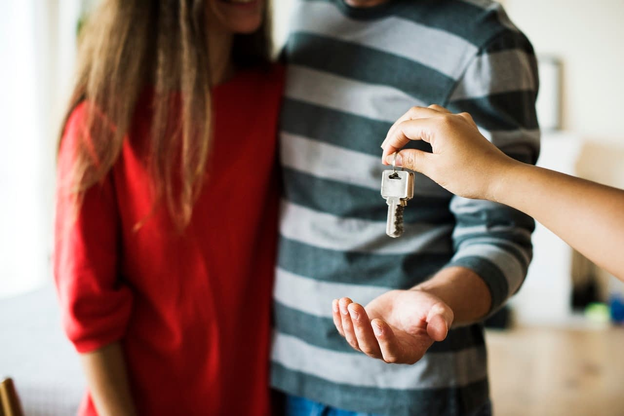 a couple receiving a house key